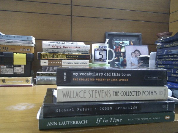 Foreground: four books from the personal canon. Background: lots of other significant stuff.